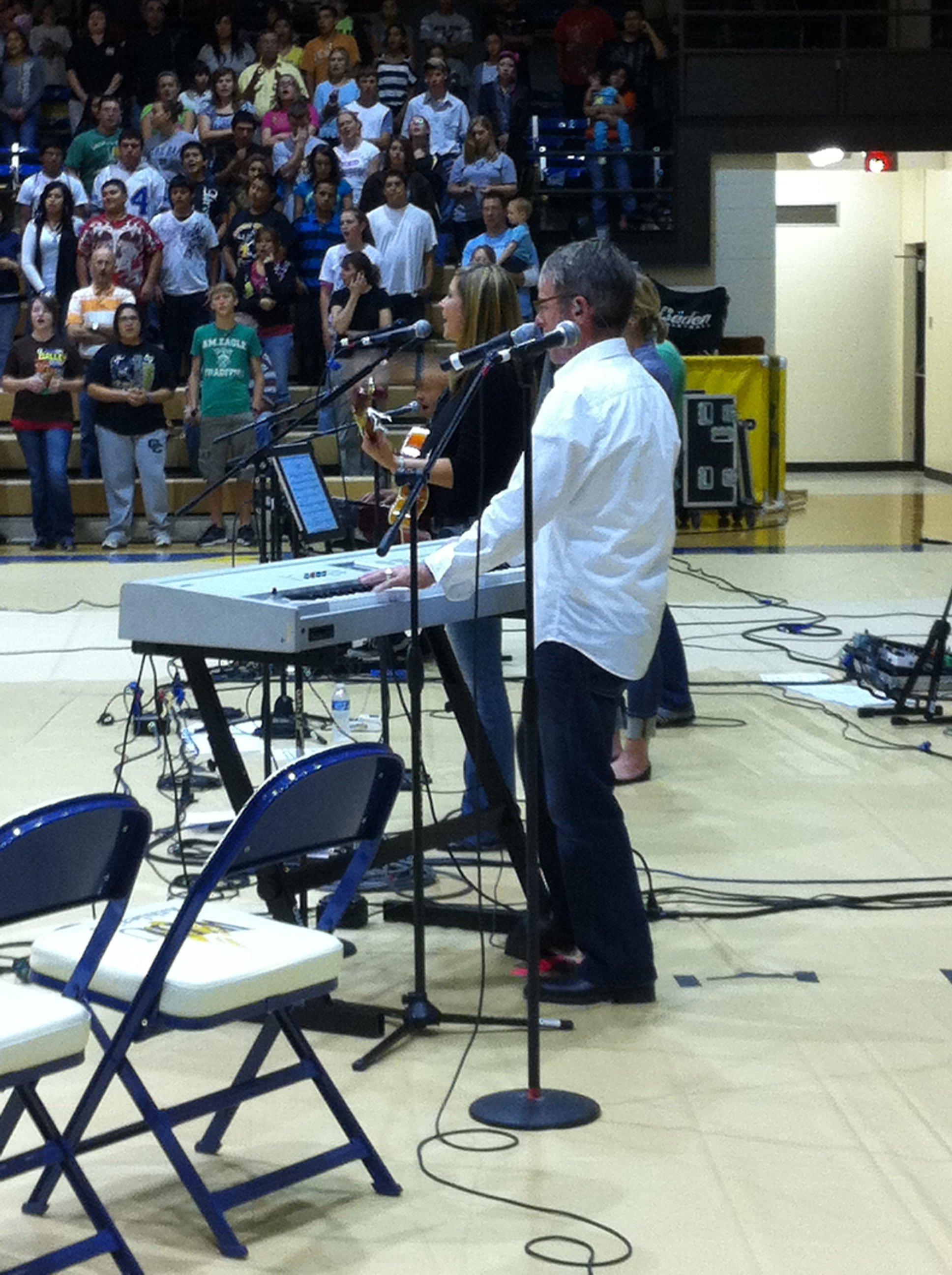 Chuck Sullivan singing, playing keys and leading worship